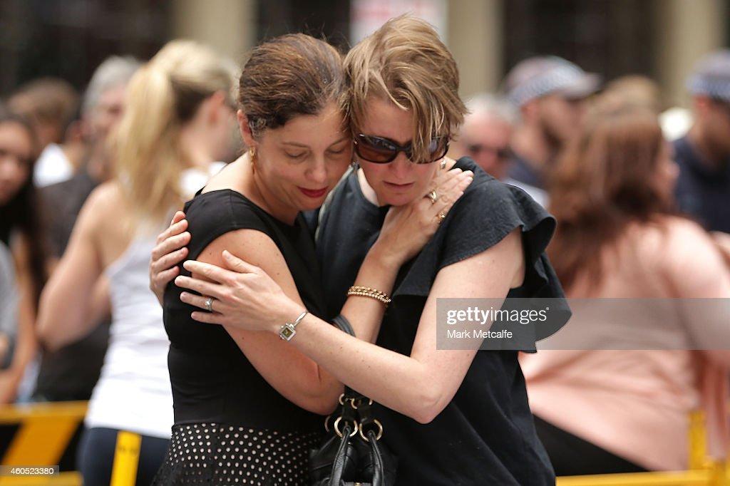 Women comfort eachother in Martin Place on December 16 2014 in Sydney Australia Sydney siege gunman Man Haron Monis was shot dead by police in the...