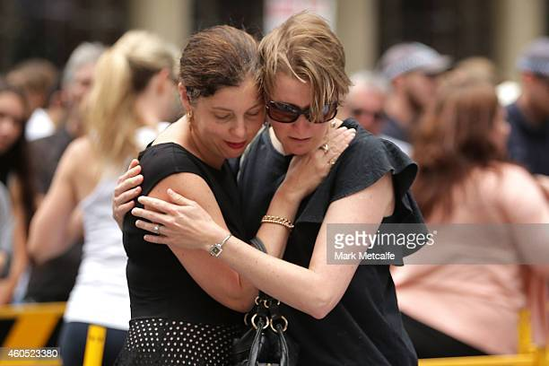 Women comfort eachother in Martin Place on December 16 2014 in Sydney Australia Sydney siege gunman Man Haron Monis was shot dead by police in the...