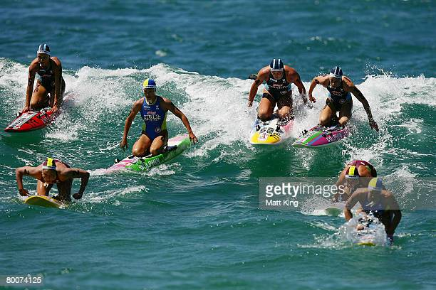 Women competitors catch a wave in the board leg during the 2008 Kellogg's NutriGrain Ironman Series Final at Coogee Beach on March 1 2008 in Sydney...