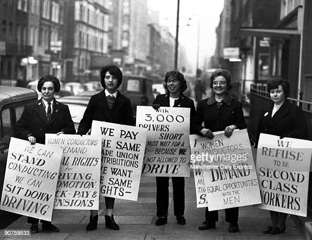 Women conductors protesting with placards 'We Can Stand Conducting We Can Sit Down Driving' �Women Conductors Demand Equal Rights for Driving...