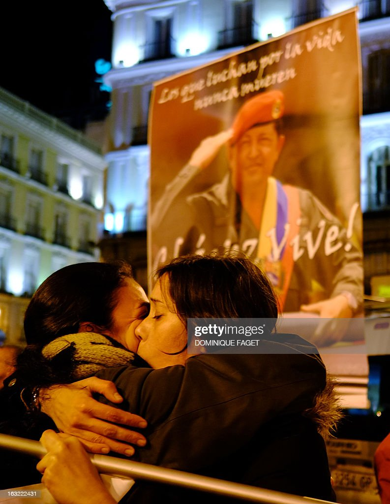 Women confort each other during a tribute to late Venezuelan President Hugo Chavez on March 6, 2013 at the Puerta del Sol square in Madrid. Venezuela was plunged into uncertainty after the death on the eve of President Hugo Chavez, who dominated the oil-rich country for 14 years and came to embody a resurgent Latin American left.