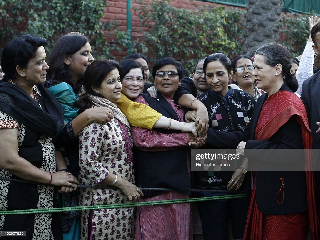 Women Congress workers greet UPA chairperson Sonia Gandhi for the budget proposal to set up India's first women's bank and other projects for women at her residence at 10 Janpath on March 2, 2013 in New Delhi, India. Presenting union budget 2013-14 Union Finance Minister P Chidambaram has announced India's first pubic sector bank for women set up with provide Rs 1,000 crore as initial investment.
