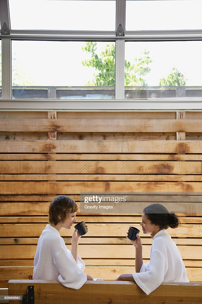Women Conversing and Drinking Tea at a Spa : Stock Photo