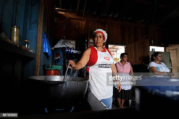 Women cook foods to be sold in some outlying areas of the city as part of the project ''Comedores solidarios'' carried out by the government of...