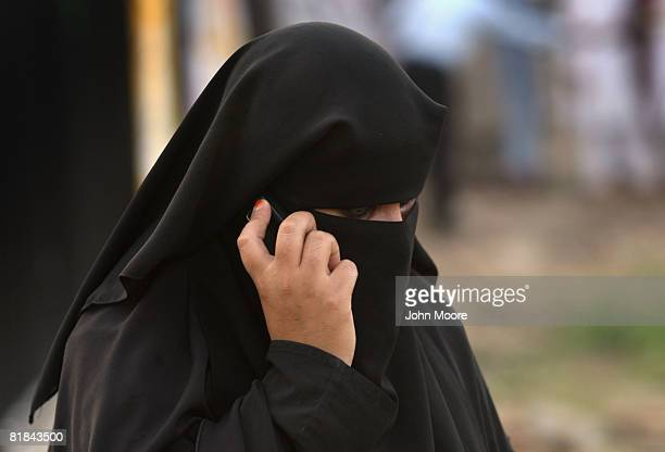 A women covered in a burqa speaks on a mobile phone outside the Red Mosque July 7 2008 in Islamabad Pakistan A day after a suicide bomber killed more...