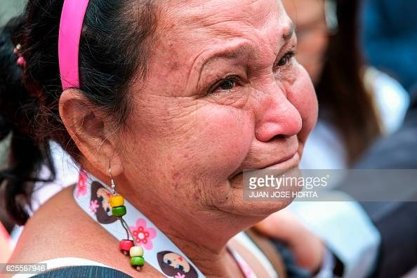 A women cries at Bolivar's square during the signing of an historic peace agreement between the Colombian government and the Revolutionary Armed...