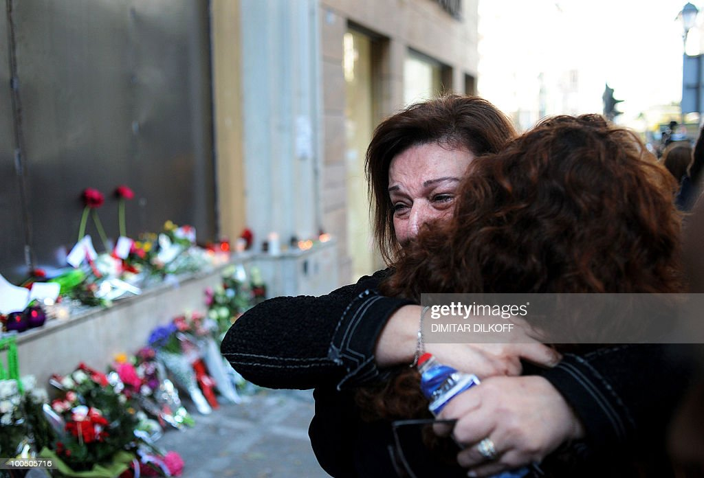 Women cry on May 7, 2010 in front of a branch of the Marfin bank where three people were killed in Athens. A fire-bomb attack on a bank in Greece killed at least three people on May 5, as police fought pitched battles with striking protestors furious at brutal budget cuts designed to avert national bankruptcy.