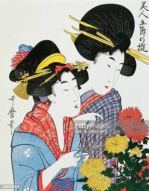 Women cutting chrysanthemums ukiyoe art print by Kitagawa Utamaro woodcut Japanese civilisation Edo period 17th19th century