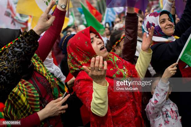 Women dance and sing as they celebrate Newroz festivities on March 21 2017 in Istanbul Turkey Newroz is celebrated by Kurdish communities around the...