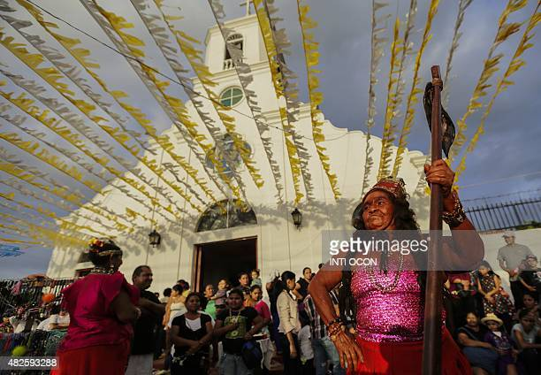 Women dance as people gather at Santo Domingo de Las Sierritas parish church in Managua on July 31 2015 on the eve of the opening of the tenday...