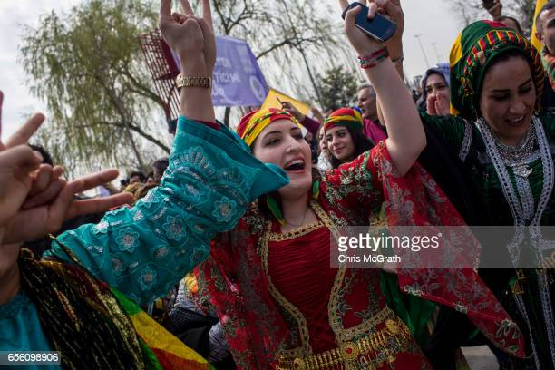 Women dance as they celebrate Newroz festivities on March 21 2017 in Istanbul Turkey Newroz is celebrated by Kurdish communities around the world and...