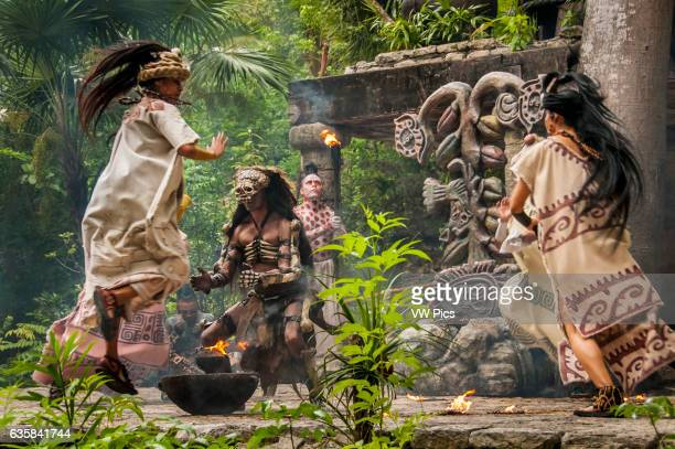 Women dancers and man portraying Ah puch Lord of the Underworld during the Maya culture performance 'Los Rostros de Ek chuah' honoring the Mayan God...