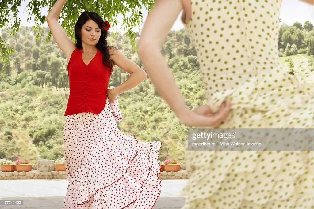 Women Dancing in Flowing Dresses