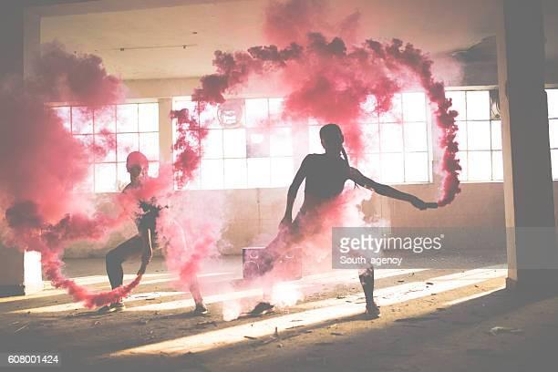 Women dancing in smoke