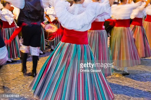 Women dancing in traditional clothing for a celebration