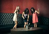 Women dancing together in nightclub