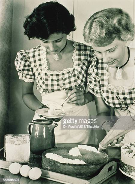 Women Decorating a Pie in the Fifties