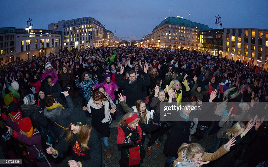 Women demonstrate for the world-wide campaign 'One Billion Rising' at the Brandeburg Gate in Berlin, on February 14, 2013. The campaign is demanding an end to violence against women as well as equal treatment and rights. It was initiated by US artist and feminist Eve Ensler in September 2012.
