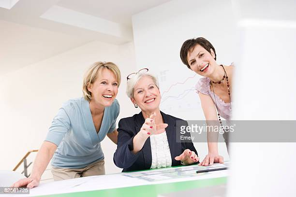 Women discussing  work