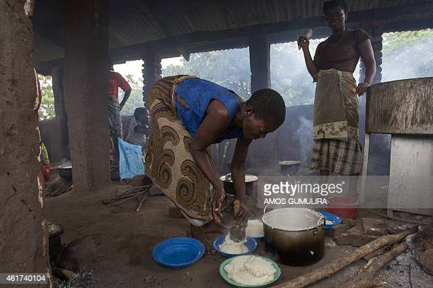 Women displaced by the recent floods prepare food at a shelter at M'bwazi Primary School in Malawi's southern Nsanje District on January 18 2015...