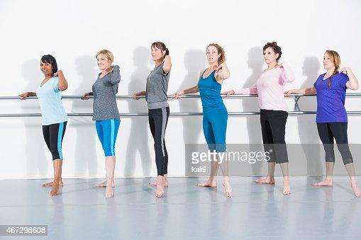 Women doing barre exercises
