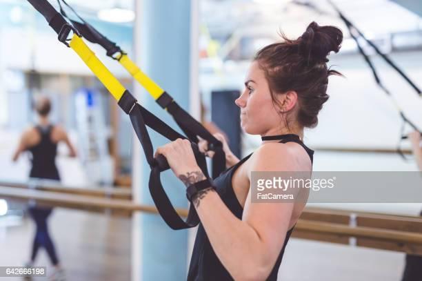 Women Doing Barre + TRX Workout