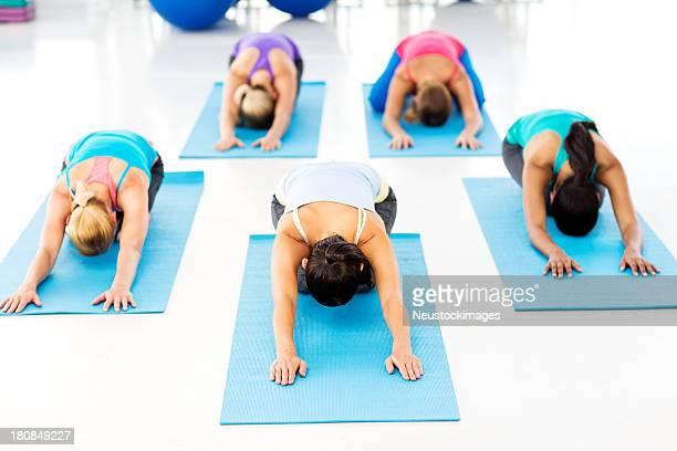 Women Doing Child Pose In Yoga Class