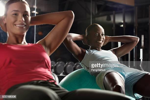 Women doing situps