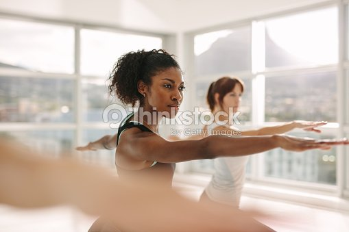 Women doing stretching and yoga workout at gym : Stock Photo