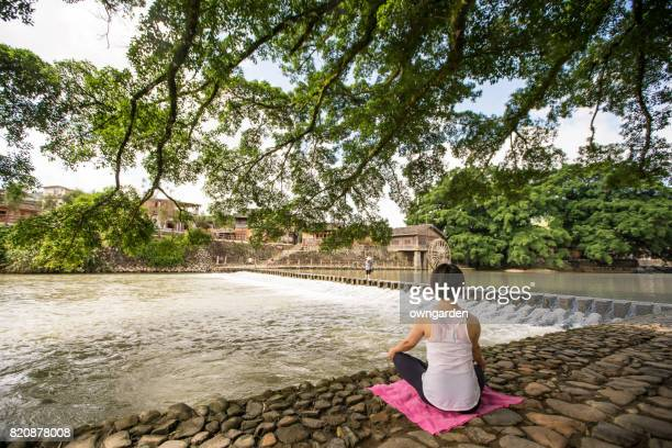 Women doing yoga in the Yun Shui Yao Ancient Town, Zhangzhou, Xiamen, Fujian, China