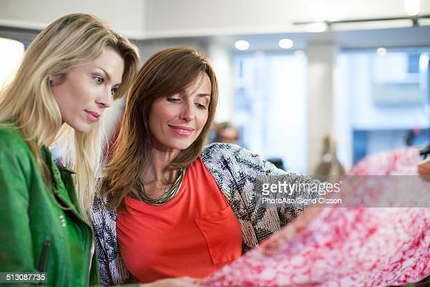 Women dress shopping together