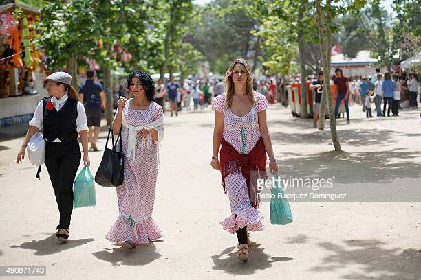 Women dressed as 'Chulapas' walk at Pradera de San Isidro park during the San Isidro festivities on May 15 2014 in Madrid Spain During the...