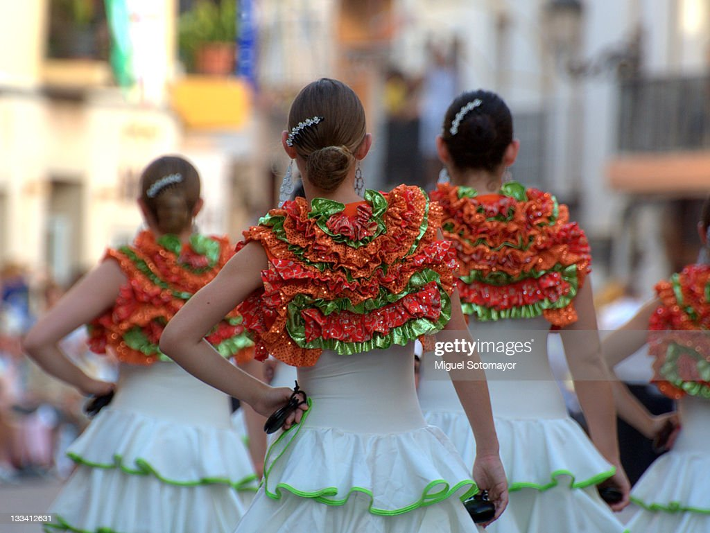 Women dressed as 'flamencas' in parade : Stock Photo