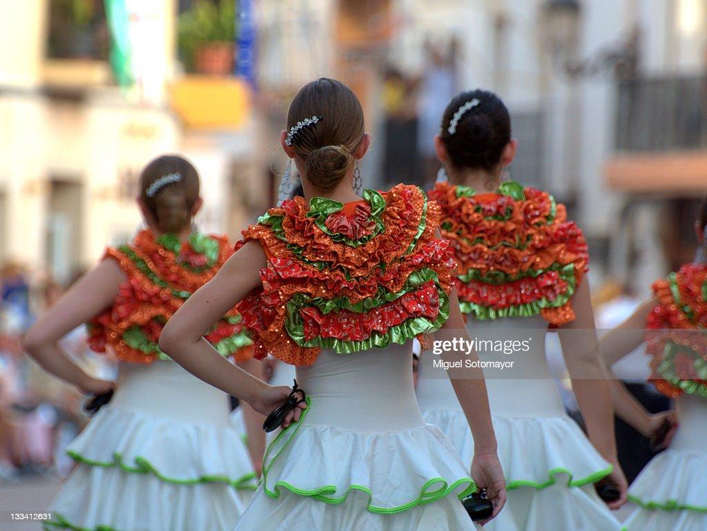 Women dressed as 'flamencas' in parade