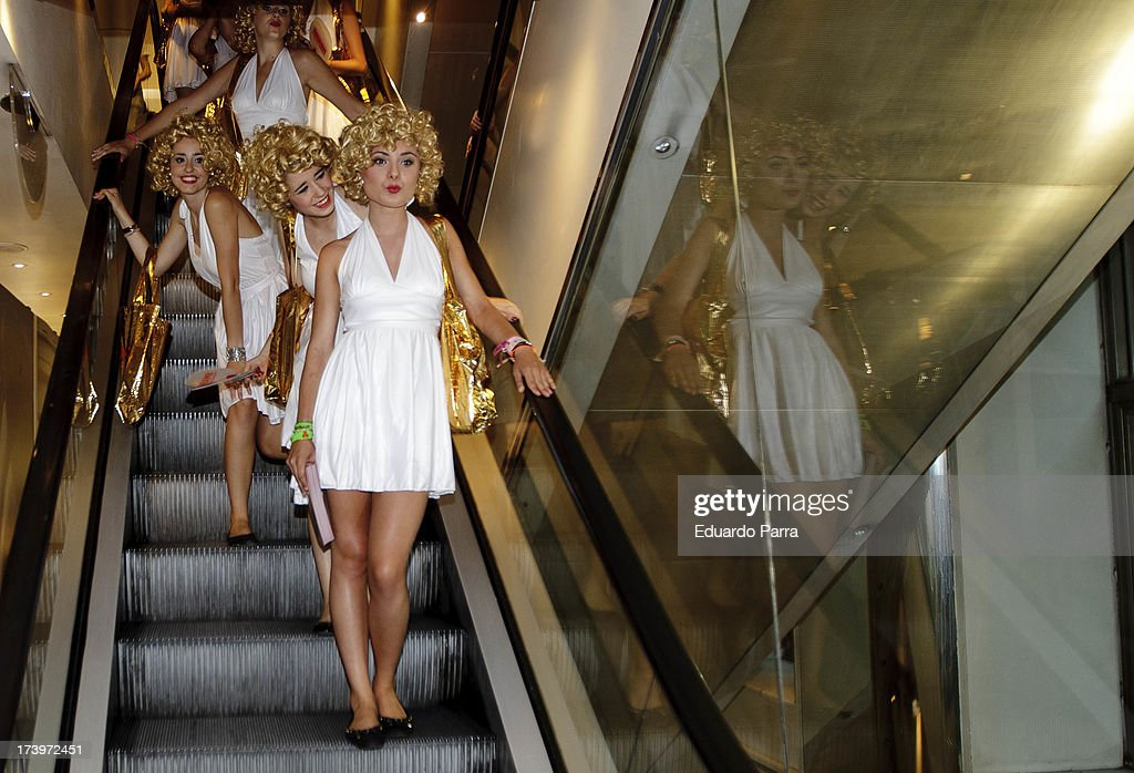 Women dressed as Marilyn Monroe walk during the presentation of the series 'Smash' at FNAC store on July 18, 2013 in Madrid, Spain.