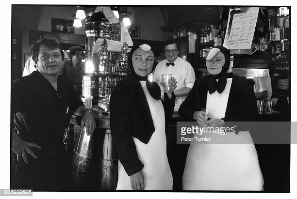 Women Dressed as Penguins in a Brasserie