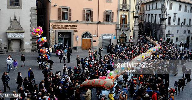 Women dressed as the witch Befana carry a 52metre long stocking full of presents during the annual Befana procession in Viterbo on January 5 2011 The...
