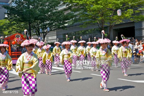 Women dressed in colorful costumes in parade