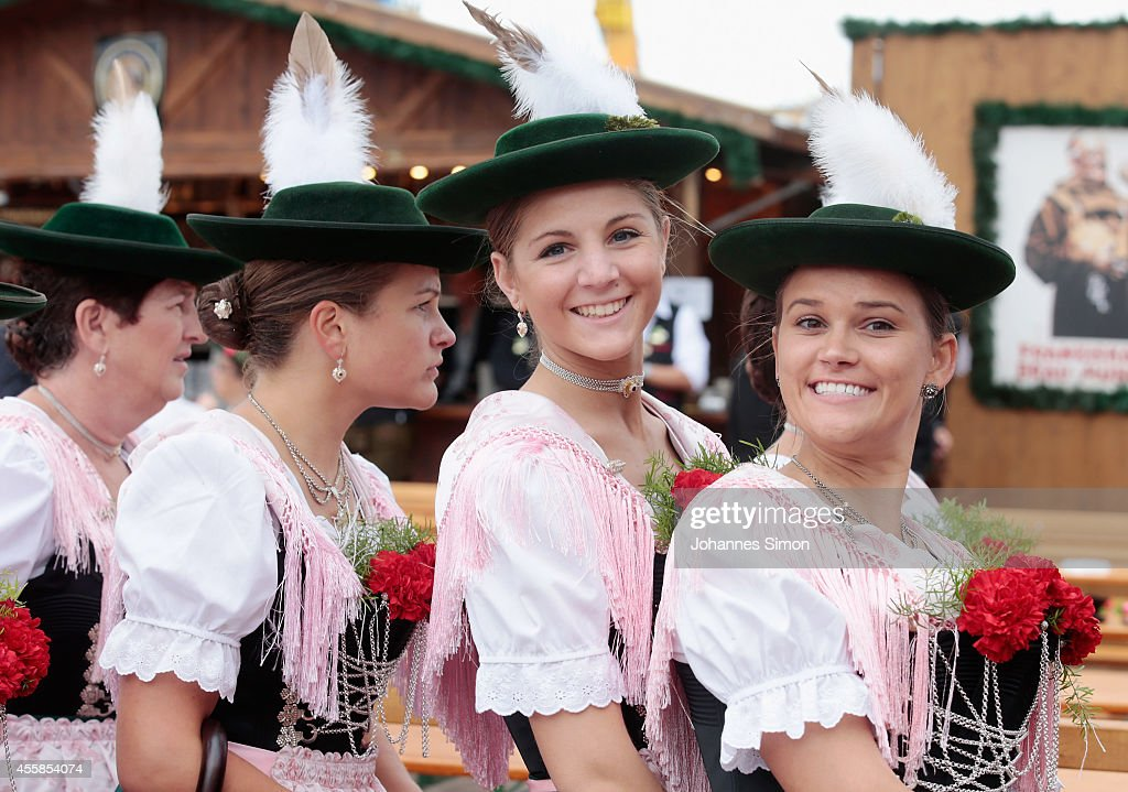 Women dressed in Dirndl and other traditional Bavarian folk dress march in the Parade of Costumes and Riflemen on the second day of the 2014...
