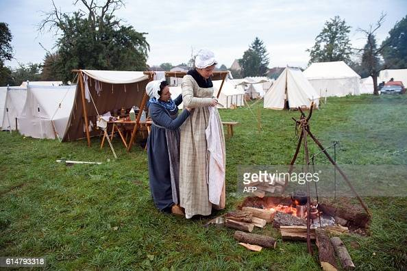 Women dressed in period clothing take part in a historical reenactment of the twin battles of Jena and Auerstedt from October 14 210 years later on...