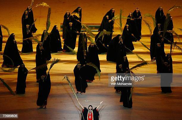 Women dressed in traditional Arabic dress perform during a rehearsal at Khalifa Stadium for the Opening Ceremony of the 15th Asian Games November 29...