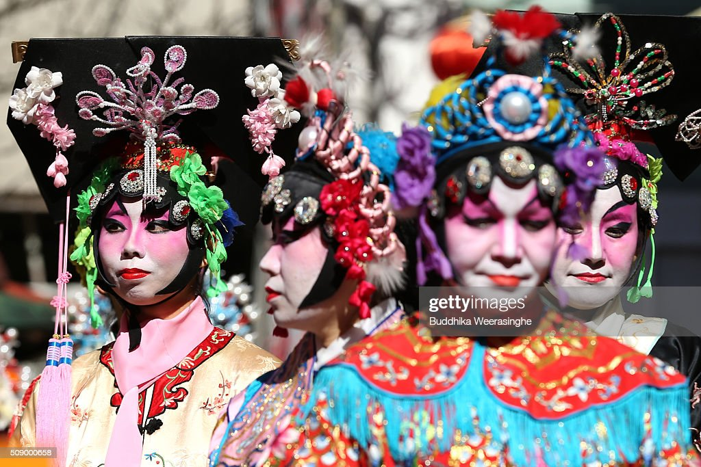 Women dressed in traditional Chinese costumes wait perform in celebration of the Chinese New Year at the Nankinmachi square, China Town on February 8, 2016 in Kobe, Japan. In Nankinmachi, the district known as Kobe Chinatown, tourists enjoyed Chinese food, lion dance and the parade organized to celebrate the Lunar New Year.