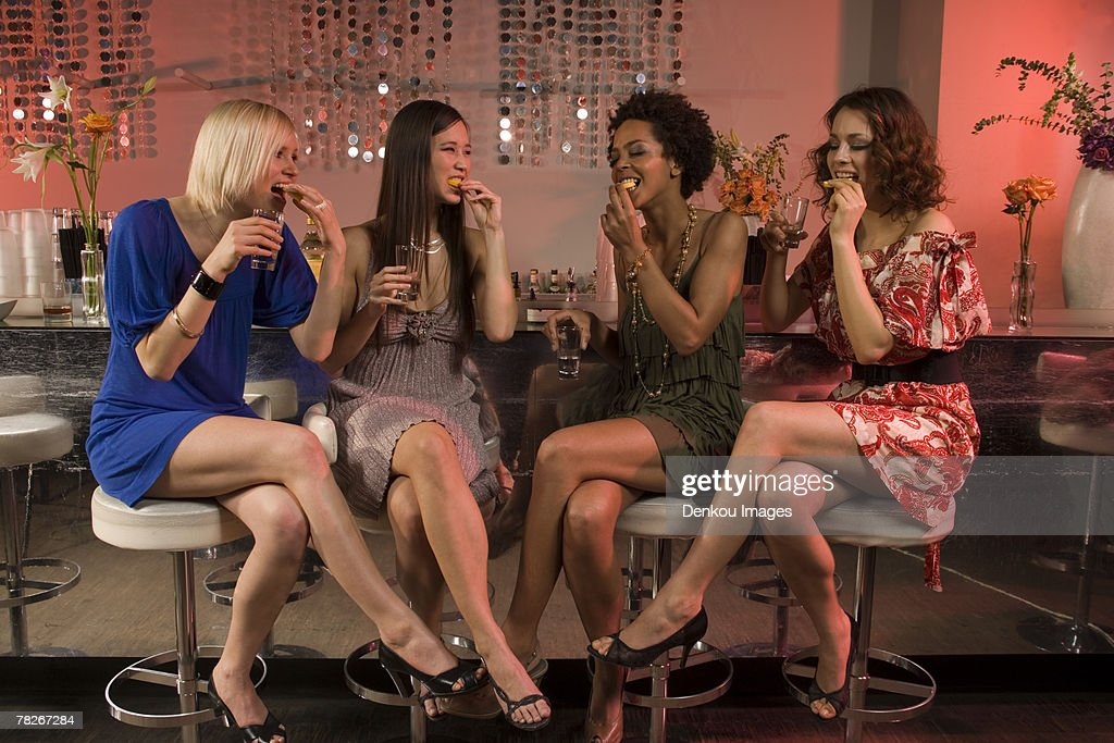 Women drinking at a bar.