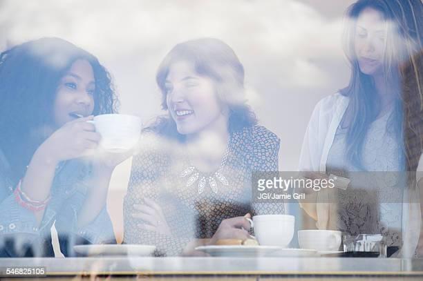 Women drinking coffee in cafe