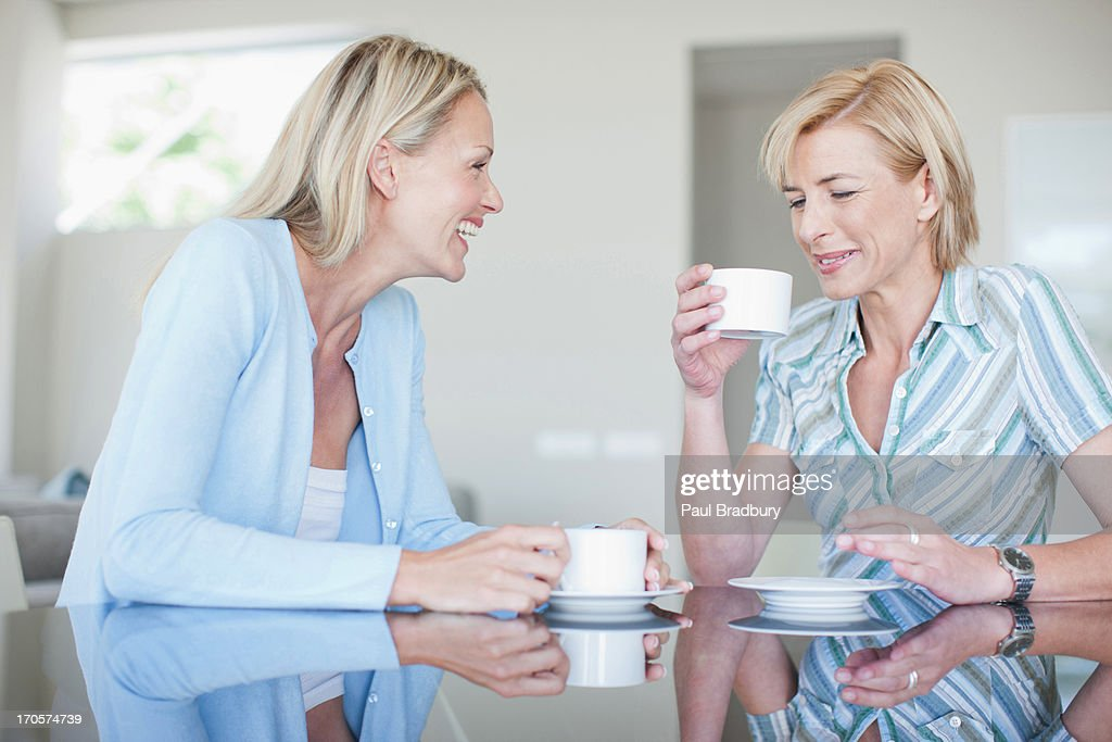 Women drinking coffee together