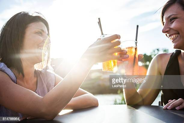Women drinking enjoying a summer happy hour