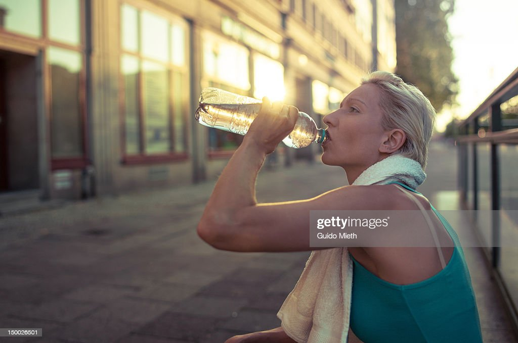 Women drinking water after sport. : Stock Photo
