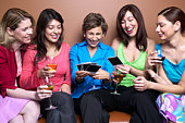 Women drinking wine and looking at pictures