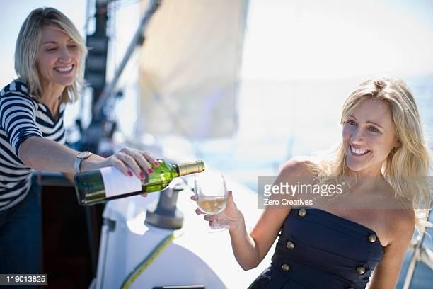 Women drinking wine on boat