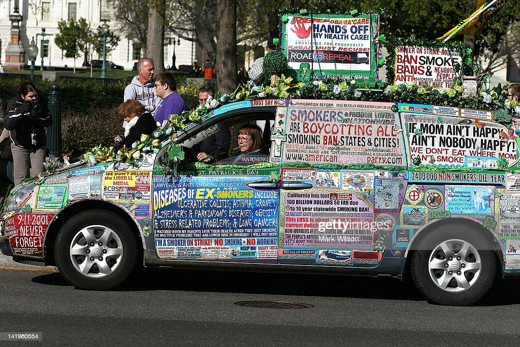 A women drives a van fully decorated in protest signs during a demonstration on the second day of oral arguments for the Patient Protection and Affordable Care Act in front of the U.S. Supreme Court building on March 27, 2012 in Washington, DC. Today is the second of three days the high court has set aside to hear six hours of arguments over the constitutionality President Barack Obama's Patient Protection and Affordable Care Act.